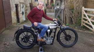 Bill Southcombe sitting on his vintage Norton CSI motorbike