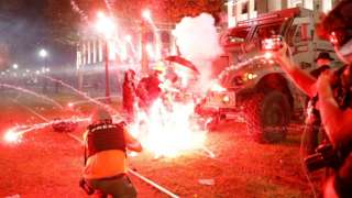 Flares go off in front of a Kenosha Country Sheriff Vehicle as demonstrators take part in a protest following the police shooting of Jacob Blake in Kenosha, Wisconsin, on 25 August 2020