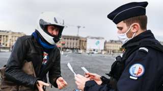 Motorcyclist and police officer in Paris