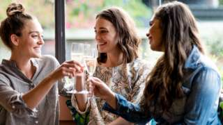 Three women drinking alcohol