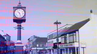 A graphic showing digital code overlaid on a photograph of Redcar town centre