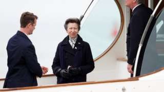 Princess Anne looks on from the boat at the Royal Yacht Squadron