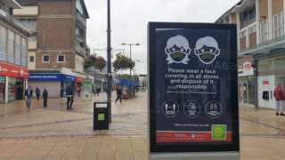 Corby high street and wear a mask sign