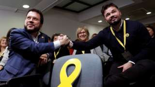 Pere Aragonès, Catalonia's vice president, and MP of Catalan pro-independence party Esquerra Republicana (ERC) Gabriel Rufian shake hands during a meeting held in Barcelona, Catalonia