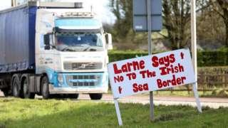 Graffiti on sign in Larne