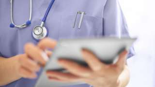 Doctor using a tablet computer