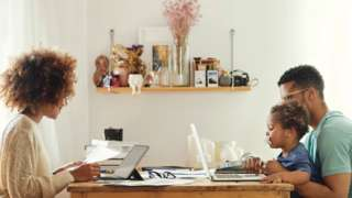 A young family working from home