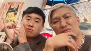 Bryanboy (R) and his friend at the Riche restaurant in Stockholm