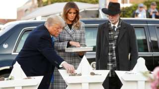 President Donald Trump places a stone as he stands with First Lady Melania Trump and Tree of Life Synagogue