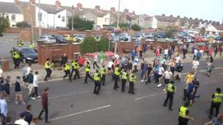 Stand off between police and football fans