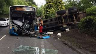 bus and tractor collision aftermath