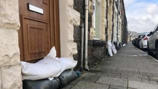 Sandbags protecting front doors on Treorchy High Street