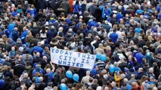 Thousands of fans walk towards the King Power stadium
