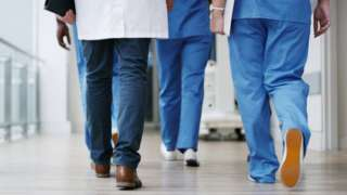 healthcare workers'' feet as they walk