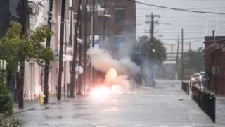 Power lines spark in flood water as Hurricale Dorian hits Charleston, South Caroline, 5 September 2019