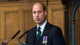 Prince William speaking at a podium at the general assembly of the Church of Scotland