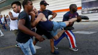 A Cuban LGBT activist is detained by plain-clothed security personnel while participating in an annual demonstration against homophobia and transphobia in Havana, 12 May 2019