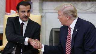 The Emir of Qatar, Sheikh Tamim Al Thani, shakes hands with US President Donald Trump at the White House (10 April 2018)