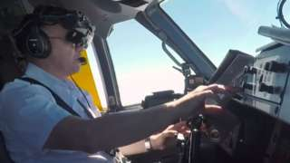 A pilot using the ClearView technology to land