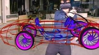Man drawing virtual car wearing VR headset