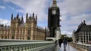 People walking outside Parliament