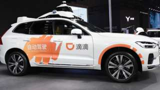 A DiDi autonomous driving car displayed on the Volvo booth during the 19th Shanghai International Automobile Industry Exhibition