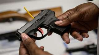 A Ruger pistol, or handgun, is displayed during a gun 'buyback' event held by the New York Police Department (NYPD) and the office of the Attorney General, in the New York borough of Brooklyn on May 22, 2021.