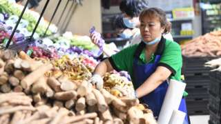 Woman in vegetable market