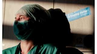 An intensive care nurse takes a break in Brussels, Belgium, 24 April 2020