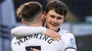 Liam Cullen celebrates scoring with Ryan Manning