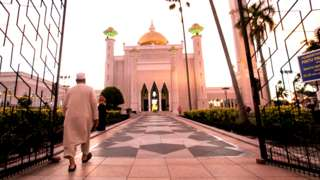 A Muslim man walks inside the Sultan Omar Ali Saifuddien mosque to perform the sunset prayer in Bandar Seri Begawan, Brunei, 01 April 2019