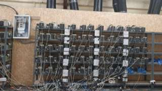 Banks of servers wired to the electricity