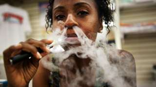 Gabrielle Ortiz smokes an electronic cigarette at Vape New York