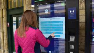 Woman at Northern ticket machine