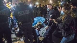 Paris police clashing with migrants at Place de la République, Paris, 24 Nov 20