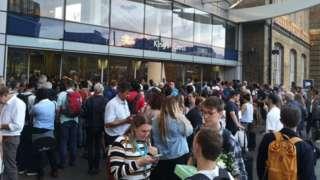 Passengers queue outside King's Cross station