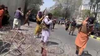 Taliban firing into the air