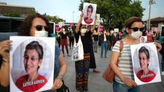 Demonstrators hold pictures of HDP lawmaker Leyla Guven