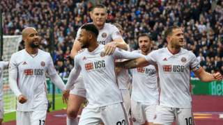Lys Mousset of Sheffield United celebrates with teammates after scoring his team's first goal during the Premier League match between West Ham United and Sheffield United at London Stadium on October 26, 2019