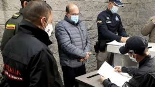 """Rodrigo Tovar Pupo (C), alias Jorge 40, upon his arrival at the bunker at the Prosecutor""""s Office in Bogota, Colombia, 28 September 2020"""
