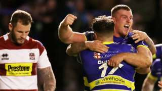 Jack Hughes of Warrington celebrates his try against Wigan