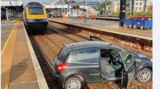 Car on railway line