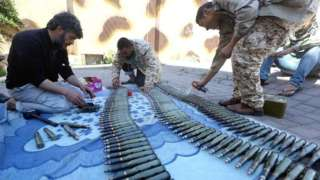 Fighters from a Misrata armed group loyal to the internationally recognised Libyan Government of National Accord (GNA) prepare their ammunition before heading to the frontline on 9 April 2019