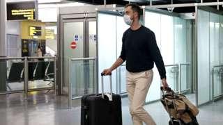 A man walking through the airport