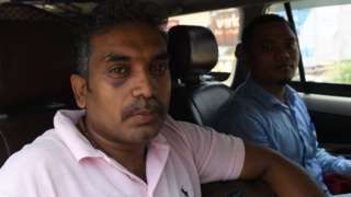 Selvadhas Paul (L) and Dwimu Brahms sit in a car at the India-Pakistan Wagah Border Post after their release from Pakistani authorities, 22 June