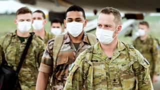 Australian Defence Force soldiers arrive in Melbourne last year to help enforce its lockdown at the time