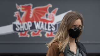 A woman wears a face mask in the town centre on October 20, 2020 in Cardiff, Wales.
