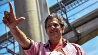 Presidential candidate for the Workers' Party (PT), Fernando Haddad, gestures as he campaigns in Sao Miguel Paulista