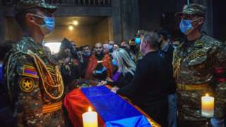 People attend a funeral service of an Armenian soldier who died in recent military clashes between Armenia and Azerbaijan