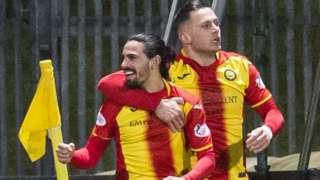 Ryan Edwards (left) celebrates scoring Partick Thistle's second goal with Miles Storey